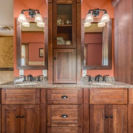 Alternate view of the Kohler Devonshire faucets. Woodpro cabinetry. Cultured marble extra thick countertop.
