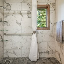 Another view of the barrier-free shower; grab bar placement and the tile is extended into the bathroom as wainscot.