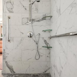 12x24 marble tile barrier-free shower.  Note the trench drain has integrated tile for the cover to blend in with the overall look.